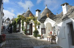 Italy (Alberobello) Beauty of Trulli shops (ustung) Tags: italy alberobello shop trulli houses building whitewashed conicalroofed nikon stree view