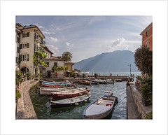 The little harbour, Limone (andyrousephotography) Tags: italy limone limonesulgarda lakegarda lake lakeside little harbour boats lemon groves film movie jamesbond 007 danielcraig quantumofsolace 2008 astonmartin dbs v12 carchase andyrouse canon eos 5d mkiii