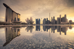 Mirror Universe (Scintt) Tags: singapore marina bay puddle rain weather storm sunset sky clouds epic surreal light glow travel tourism reflection symmetry mirror urban skyline cityscape city water tarmac mbs hotel artscience museum tanjong pagar raffles place central business district cbd financial offices tall skyscrapers scintillation scintt jon chiang photography