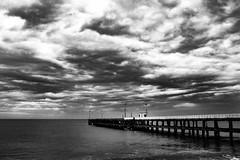 "<<untitled>> (""The Wanderer's Eye Photography"") Tags: canoneos450d canon eos dslr canoneosrebelxsi digitalphotography india photography rubenalexander susanalexander thewandererseyephotography 2016 pondicherry puduchery pier sea seaside seascape clouds blackwhite blackandwhite bw monochrome promenadebeach rockybeach snapseed adobelightroommobile pondi travel travelphotography moody cloudy"