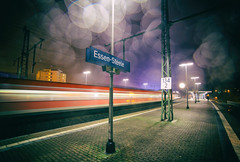 as trains go by (Blende57) Tags: train trains station trainstation platform night rain drizzle raindrops longexposure wideangle motion speed blur motionblur lighttrails