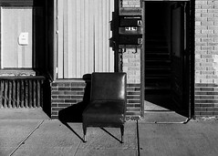 A Place to Sit - Alamosa, Colorado (ddurham000) Tags: chair sidewalk doorway alamosa colorado rural town mailboxes
