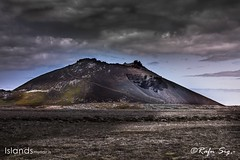 Volcano on a dark cloudy day