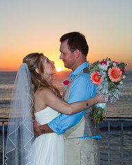 Bobby and Melyssa 0692 (casch52) Tags: ocean travel wedding sunset sea summer vacation two sky people woman sun holiday man flower male love beach nature water beautiful smiling female happy groom bride holding kiss couple paradise honeymoon married dress outdoor young ceremony handsome marriage wave happiness husband romance relationship together attractive tropical wife romantic bouquet tranquil