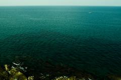 Mare (farmerofarmer) Tags: autumn sea italy fall tourism nature water rock stone landscape boat europa europe barca italia mare ship wave natura sicily minimalism palermo minimalismo acqua pietra turismo autunno sicilia paesaggio onda  cefal