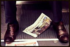 2014 #297 (danieljsf) Tags: feet newspaper shoes muni giants worldseries examiner