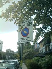 London Street Art: Controlled by Agreement (koothenholly) Tags: london cletabraham batterseachurchroad battersea londonstreetart roadsigntransfer