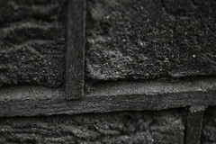 Dark segments (Djaron van Beek) Tags: abstract closeup bricks material raw rough erosion black darkshades anthrasitetones wall detail builtin1873 urban geometry rectangles outdoor beautyofdecay monochrome minimal basic simple composition pattern connected lines stone mortar mortarandbrickssamecolour depthoffield dof bokeh notblackandwhite fullscreen division angle borders edges shrunken texture greytones gray gloomy dark somber massive lowkey bricksreallyinthisdarkcolour notthatmuchprocessed minimalism djaron djaronvanbeek