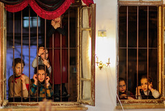 The men are dancing inside. The women and girls are looking through the windows (ybiberman) Tags: israel jerusalem meah–shearim suckot sukkot girls window synagogue looking night candid streetphotography curiosity