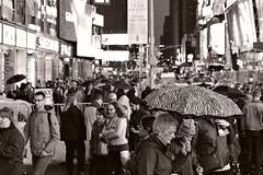 October 22 2016, Times Square (sjnnyny) Tags: timessquare manhattan nyc theaterdistrict pentaxk3ii pentaxfa50mmf14 sidewalk shoppers tourists nightphoto streetphoto downtown crowded people umbrella diverse stevenj sjnnyny urban sightsee signage illuminations