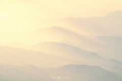 Caricias de luz (Mimadeo) Tags: mountains mist landscape haze peaks range nature mountain outdoor aerial remote far scenery slopes group distant scenic gradual repetition layer away layers valley mountainrange mountainpattern morning transition misty hill warm sunset sunrise highkey hazy fog foggy