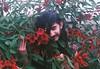 (Hijo de la Tierra.) Tags: analog film 35mm grain vintage old red tree ceibo uruguay boy longhair hijodelatierra being nature life rainyday spring flowers people portrait selfportrait