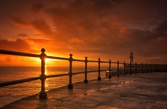 Burst of Light (Captain Nikon) Tags: mevagissey mevagisseyharbour seawall railings sunrise lighthouse southwest cornwall southcornwall sunburst