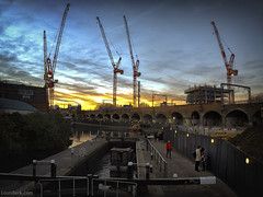 Sunset, Cranes and a Kiss (louisberk.com) Tags: hawley wharf camden town lock sunset dusk cranes building canal regents construction railway arches line overground lovers kiss affection embrace romantic london england leica q