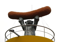 Sausage-lifting bear (Sparky the Neon Cat) Tags: europe germany deutschland berlin mitte zimmerstrasse sausage wurst frankfurter bear sculpture