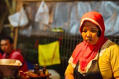 Muslim Hands-Free Mobile Phone, Bali Indonesia (AdamCohn) Tags: adamcohn bali indonesia muslimwoman seminyak ubud cellphone handsfree hijab market marketplace mobilephone vendor wwwadamcohncom