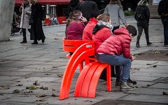 The Red Team (DobingDesign) Tags: streetphotography southbank london street people bench jeppehein modifiedsocialbenches artinstallation resting waiting family curve lines jackets coats fluorescent tones warmhues anoraks sitting bright saturated streetart streetfurniture