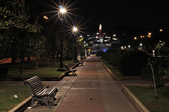 Alone in the park (Daniel Nebreda Lucea) Tags: park parque nature naturaleza city ciudad night noche light luz perspective perspectiva canon 60d urban urbano alone solo atmosphere atmosfera shadows sombras travel viajar sunset atardecer street calle zaragoza aragon spain espaa europe europa trees arboles seat sitio bank banco empty vacio