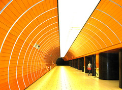 Getting out, Munich, Germany, August 2008 (Juha Riissanen) Tags: munchen germany underground orange tube red light tunnel vanishingpoint woman doors perspective leaving going metro