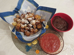 Fried pâte à choux, pets de nonne, sufganyot, French crullers, with berry and chocolate sauces. (Traveling with Simone) Tags: petsdenonne crullers pâteàchoux chanukah fried berry chocolate holiday indoor food dessert sweet sucré sugary