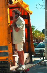 Hey......were rolling........! (Phillloyd fotographie) Tags: street white man yellow truck cellphone bluesky greece parcels lorry rolling inmotion