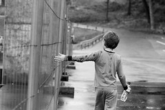 IMG_1966 (zokamoka) Tags: street city boy bw white black green cars wet water rain weather norway fence town kid industrial alone child hand sad gray lonely telemark skien