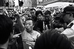 Skirmishes 3 (Aaron Guy Leroux) Tags: blackandwhite bw youth hongkong streetphotography photojournalism ap mongkok reuters latimes associatedpress umbrellarevolution zeiss35mm sonya7 aaronguyleroux occupyhk occupyhongkong occupycentral oclphk