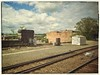 24 May 2014 (Rob Rocke) Tags: travel trees windows clouds buildings traintracks structures trains amtrak transportation manmade gravel portals railroads throughawindow railyards vermonter fauxvintage fauxaged builtenvironments snapseed