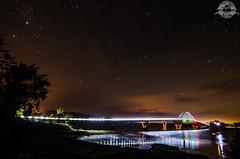 Lake Champlain Bridge (alistaircassidy) Tags: road bridge sky lake newyork america reflections river stars landscape lights nikon vermont adirondacks nightsky lakechamplain tokina1116 d5100