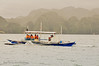It's rain or shine (pickled_newt) Tags: tourism island boat philippines sightseeing tourists coron banka sietepecados outriggerboat baroto