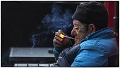 Lighting-up time (Frank Fullard) Tags: street ireland light portrait irish galway cigarette candid smoke smoker fullard frankfullard