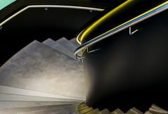 Slipping under, sliding down (Maerten Prins) Tags: light black green yellow metal stairs corner silver dark deutschland stair steps stairwell step railing curve shining dortmund duitsland explored