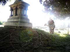 In Broad Daylight (Studio d'Xavier) Tags: werehere thegraveyardshift inbroaddaylight graveyard cemetery clown creepyclown 365 october192016 293366 flare