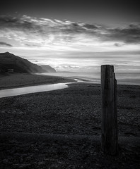 Charmouth Post (Sarah_Brooks) Tags: charmouth dorset godlencap beach sea mono monochrome bw seascape post
