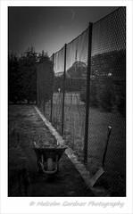 Fence makes a wonderful Prop HFF (M Gardner Photography) Tags: happyfencefriday chainlinkfence shovel wheelbarrow fence resting takingabreather fenceline perimeterfence