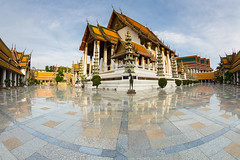 Wat Suthat Temple (baddoguy) Tags: ancientcivilization architecture art bangkok buddhism capitalcities chapel clearsky colorimage copyspace famousplace horizontal landscape majestic marble nationallandmark nopeople outdoors photography reflection religion southeastasia surfacelevel templebuilding thaiculture thailand tile tourism tradition traveldestinations twilight unusualangle watsuthattemple wideangle