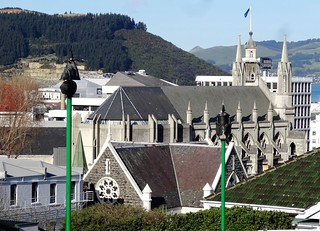 Dunedin. The Anglican Cathedral from the rear with the city centre and the harbour.