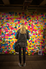 Not Her President? (si_glogiewicz) Tags: protest post it notes 14th street station subway nyc new york city protester colour single female commuter girl lonely contemplate thinking president