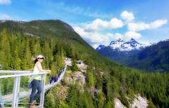 Squamish suspension bridge British Columbia (yuanxizhou) Tags: beautiful landscape scenery nature wilderness vancouver britishcolumbia westcoast blue snow bridge tree forest cloud sky mountain