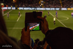 Screen time (Alex Chilli) Tags: crystal palace football club red blue selhurst park norwood pitch stands seats crowd people fans players goal goalkeeper view phone screen mobile picture take london se25 canon eos 70d