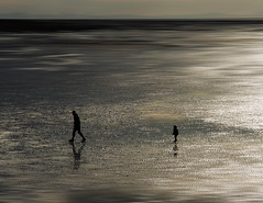 Don't Leave Me.. (Philip R Jones) Tags: lonely minimalism negativespace ruleofthirds silhouette seaside boy father son dad daddy