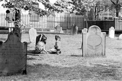 060568 31 (ndpa / s. lundeen, archivist) Tags: nick dewolf nickdewolf photographbynickdewolf blackwhite bw 1968 1960s 35mm june beaconhill candid boston massachusetts ma city citylife streetlife sliceoflife film monochrome blackandwhite spring cemetery graveyard buryingground granaryburyingground grave graves tombstone tombstones gravestone gravestones gravemarker gravemarkers children kids girls child girl nicole pagecollingwood collingwood fence ironwork