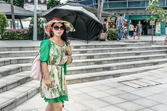 Woman with umbrella (Triyadi Wijaya) Tags: street camera people woman color eye girl lens candid sony small streetphotography z contact alpha sel caught ep compact humaninterest ilce 1650 lenskit fullcolors interchangable mirrorless 1650mm a6000 sel1650 sel1650mm alpha6000 ilce6000