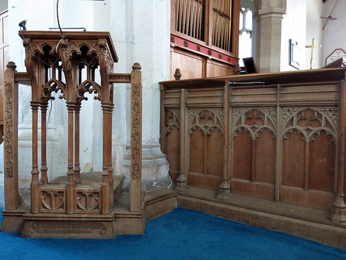 The lectern (probably 19th C.), well-matched to the dado of the 15th C. rood screen, the Church of St Peter and St Paul, Fressingfield, Suffolk, England