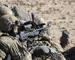 FORT IRWIN, Calif. - A U.S. Army Ranger, assigned to Alpha Company, 1st Battalion, 75th Ranger Regiment, directs his gun team to provide suppressive fire on an enemy compound during Decisive Action Rotation 15-02 here, Nov. 15, 2014. The decisive action r (Operations Group, National Training Center) Tags: california camera usa us calif assault soldiers rangers troops enemy mohave ntc fortirwin nationaltrainingcenter alphacompany 1strangerbattalion opsgroup combatphotographers vultureteam traintheforce sgtrichardwjonesjr