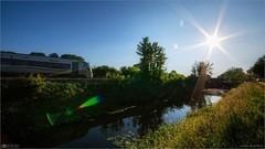 Into the Evening Sun (bbusschots) Tags: bridge summer train evening canal lock rail sunburst irishrail dmu photomatix tonemapped topazadjust topazdenoise classie22000dmu3