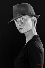 Alexandra (7) (Yasur.sur.Flickr) Tags: portrait bw woman monochrome hat studio 50mm nikon noiretblanc femme highcontrast alexandra chapeau blonde profil fondnoir d7000 contrasteélevé