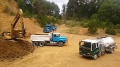 Work o'clock (nanlrider) Tags: summer cat tipper working australia s line international tasmania tanker fuel gravel digger iveco excavator isuzu sline powerstar