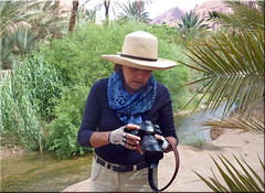 preparing the camera for the next foray (mhobl) Tags: camera photographer sony oasis morocco maroc