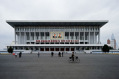 one of those buildings with pictures of the Kims (jonas_k) Tags: travel northkorea pyongyang dprk pjöngjang